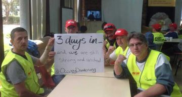 Factory workers stage sit-in