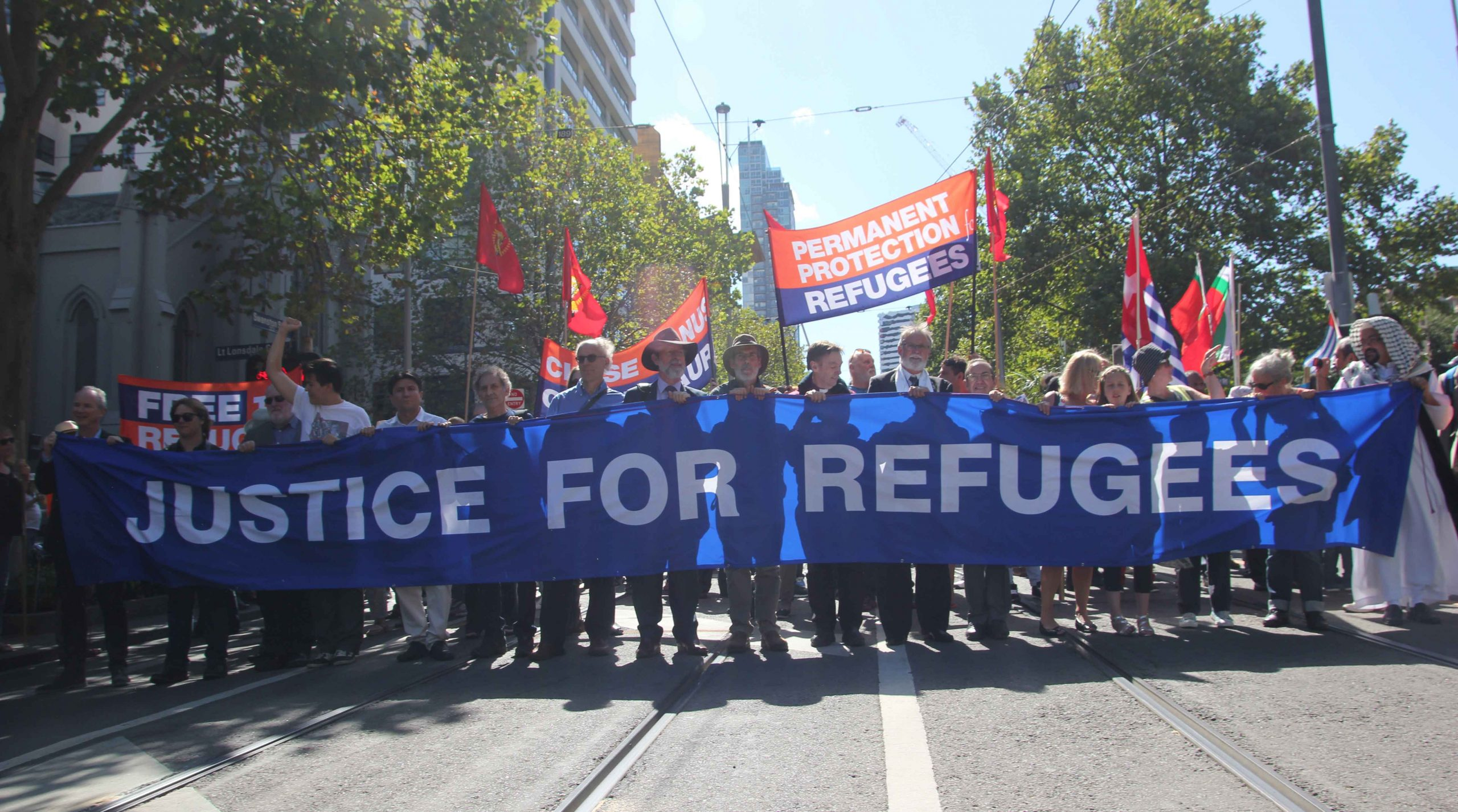 Couple protests and direct action to stop cruel refugee policies