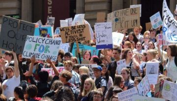 Students walk out of class, demand climate action now